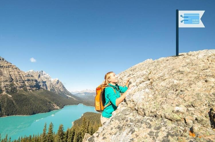 Woman climbing mountains to reach virtual cards that earn $$$ for Your Organization