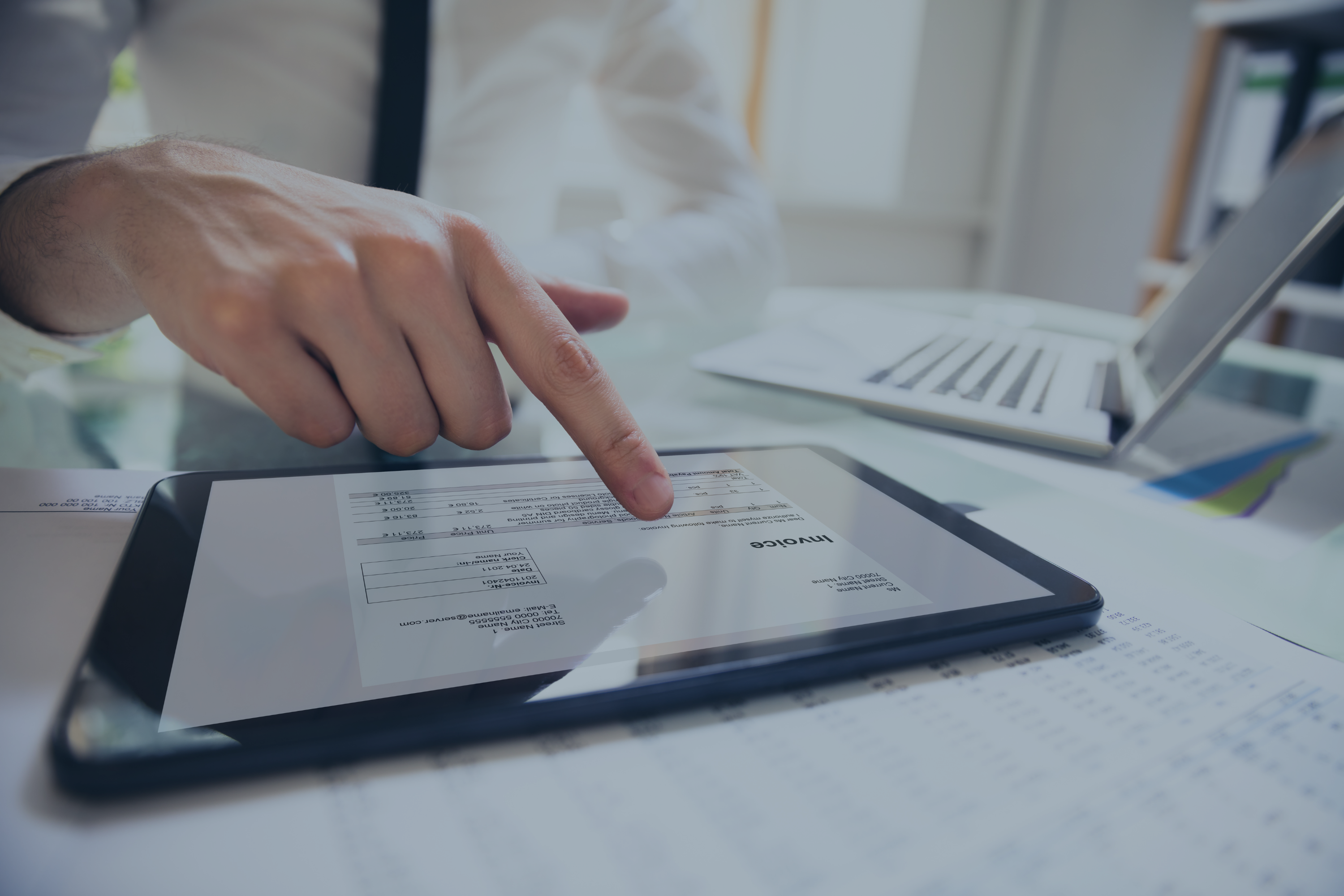 Businessperson-analyzing-invoice-on-digital-tablet