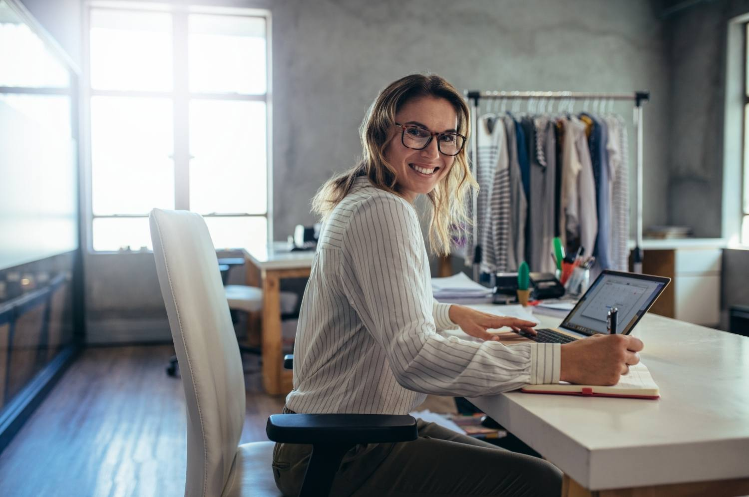 Happy woman business retail owner running online store from her home desk