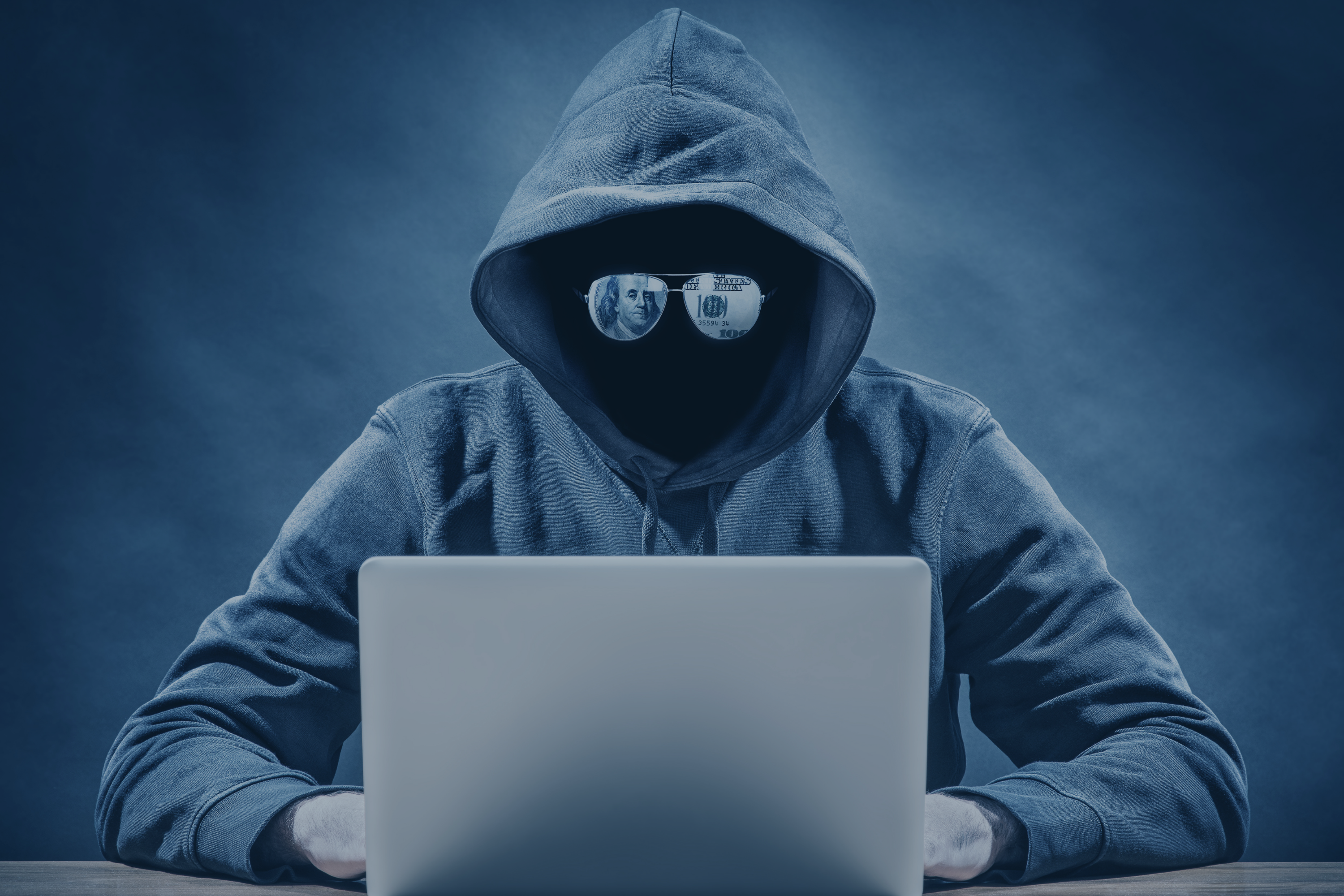 crimial-person-on-a-computer-comitting-payment-invoice-fraud