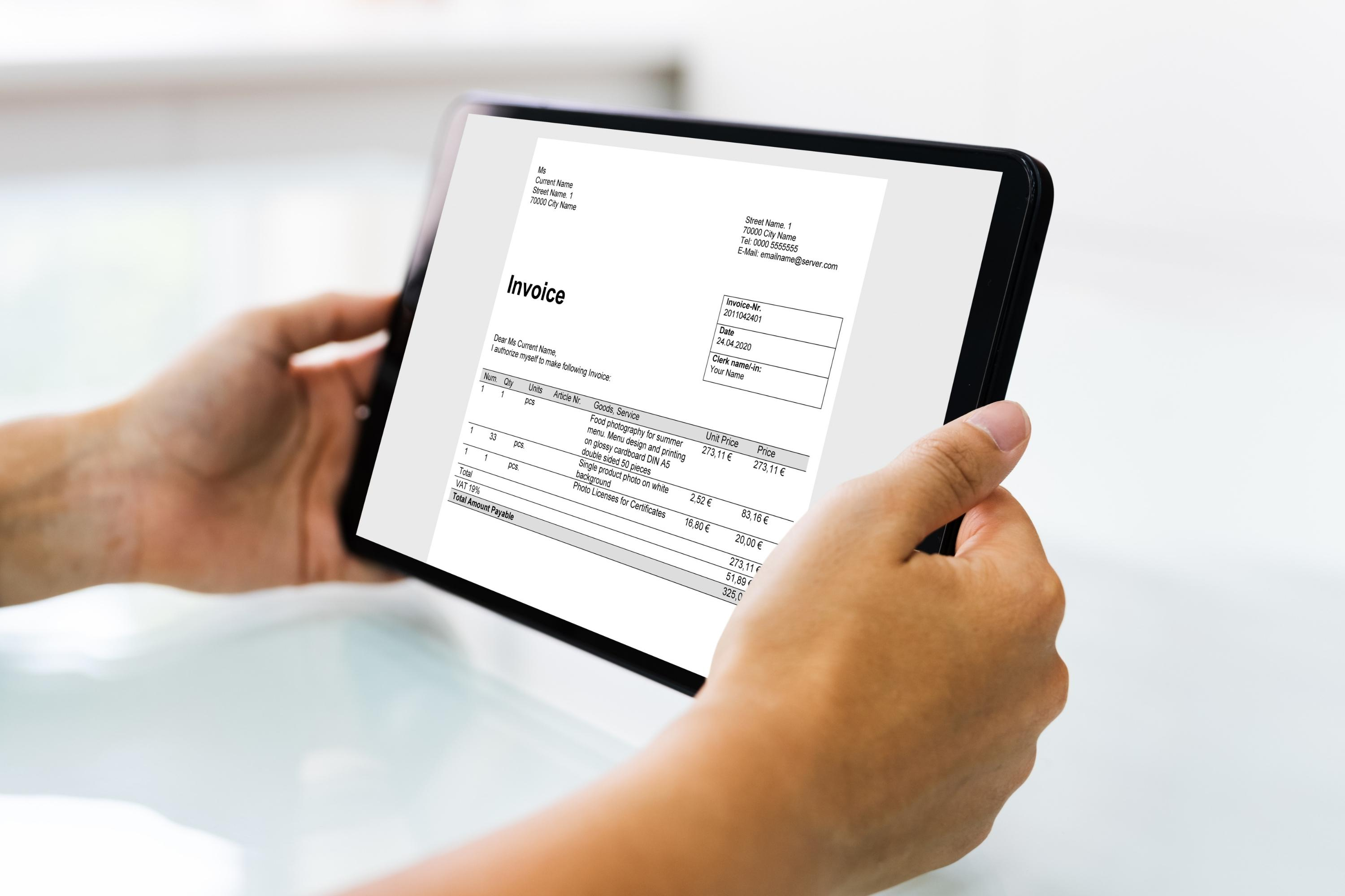 electronic-invoice-and-accounting-software-on-table