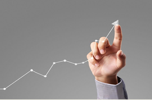 finger pointing to revenue chart going up