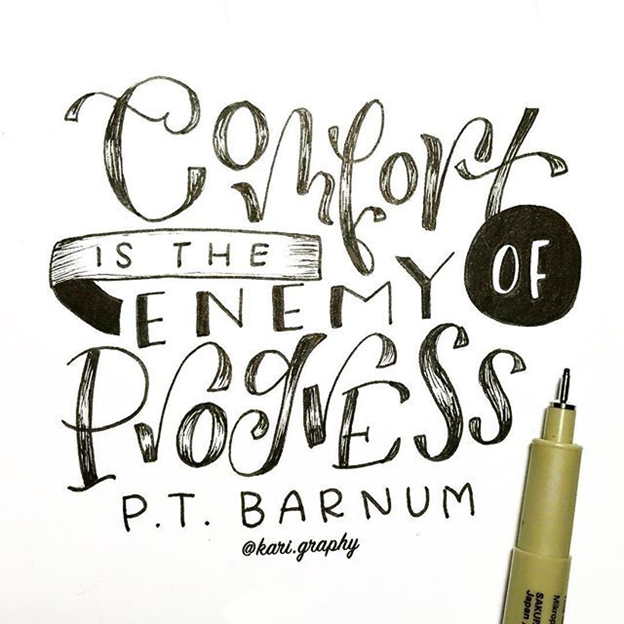 comfort-is-the-enemy-of-progress-quote-from-pt-barnum-concept-over-paper-next-to-pen