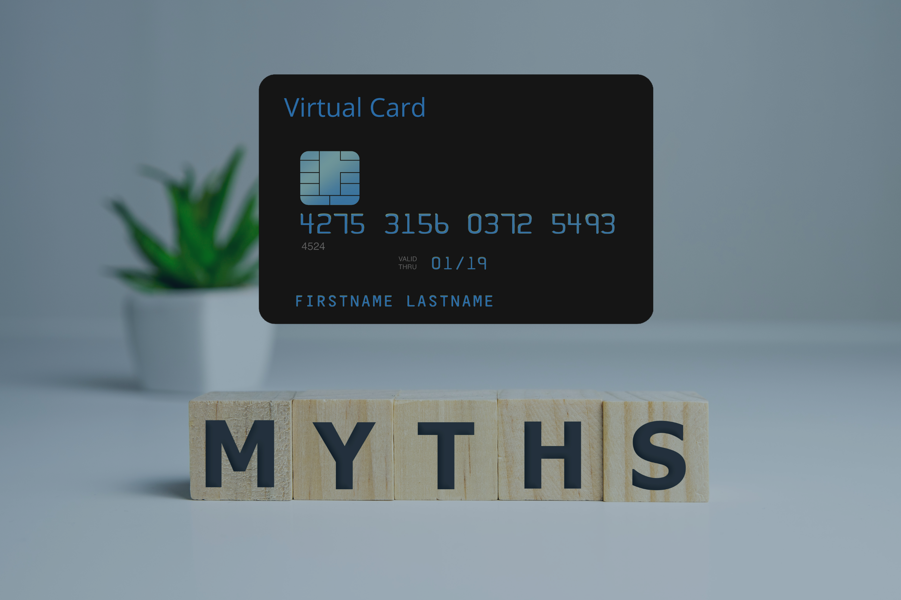 virtual_card_hovering_over_myth_word_on_wooden_cubes