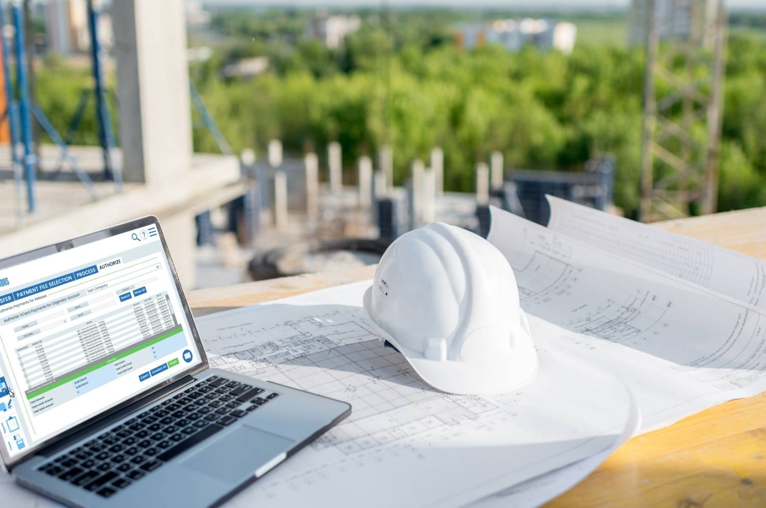 laptop at construction job site with virtual cards pulled up for remote approval